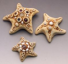 "polymer clay starfish by Christi Friesen  Want to make your own? Project is in the ""Under the Sea"" book!   #polymerclay #christifriesen #starfish #pearl #beads"