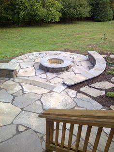 Stone fire pit with mortared Bluestone cap.