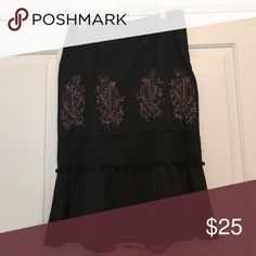 Skirt Below the knee skirt with gold leaf detail, small pompons and ruffled bottom; side zipper Skirts Midi