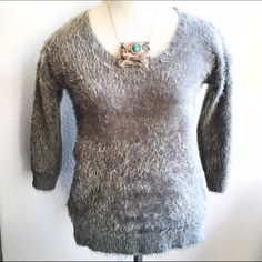 New Listing! Soft Gray Fuzzy 3/4 Sleeve Sweater This sweater is so soft and cozy!! Excellent used condition, by Apt. 9, brand sold at Kohls. It's a soft, fuzzy material, no itch factor whatsoever! Scoop neckline and 3/4 sleeves. Perfect for the season! Looks great dressed up or worn with jeans. Size Medium. Apt. 9 Sweaters Crew & Scoop Necks