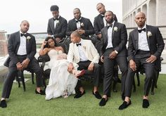 Photo of bride with groom and groomsmen