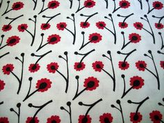 Red, white and black - a christmas fabric that isnt too christhmasy! Red and Black poppies bloom on this 45 inch wide cotton fabric. This fabric is