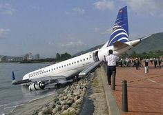 Weird Car Crashes. Part 2  Izismile.com - On 17 July 2007, an Embraer ERJ-190 aircraft with the registration HK-4455, operating as AeroRepública Flight 7330, overshot the runway at Simón Bolívar International Airport in Santa Marta, Colombia, went down an embankment and came to rest with its nose in the ocean. There were no fatalities. Due to the extensive damage, the aircraft was written off.