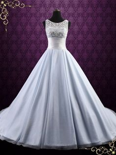 Beautiful Frozen inspired ice blue wedding gown with bodice with snowflake inspired embroidery, accented with ivory beadings, perfect for your winter wedding. Photoed in ice blue. This dress can also