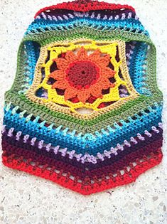 This is a vest-pattern that is worked in the round. Made with an interesting mandala sunflower motif in the center, it is a relatively simple pattern once worked. Utilizes no special stitches, this is an approachable pattern for an intermediate beginner and up.