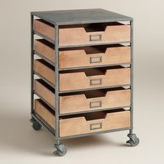 Papers, office supplies and odds and ends all find their proper place in our brushed metal cart, furnished with five wooden drawers, handy label holders and casters that swivel and lock.