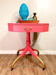 """New at the coop....Coral! This end table has been finished in a beautiful shade of coral and has it's original pull and castors."" - Painted Coop Design  See more design ideas styled in Coral Crush Milk Paint by going to GF's Design Center at http://bit.ly/2g0MA76."