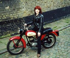 Lois Pryce (website) and her cute retro ride. Redhead + red bike = fiery and awesome! Lois is a writer and logs her travels in book form (you may have heard of those things once or twice) with accompanying photography.