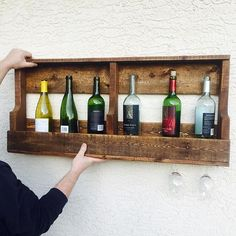 Rustic wine rack with glass storage on the bottom. Made from reclaimed pallets.  #wine #winerack #pallet #palletwood #wood #woodworking #rustic https://www.etsy.com/ca/shop/RusticwoodworkbyJL