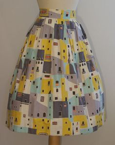 I just love high-waisted skirts! And the pattern on this one rocks! :)