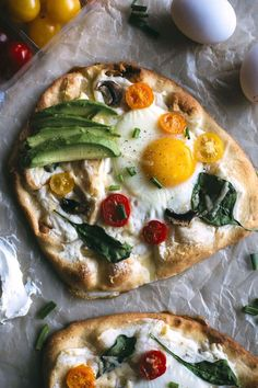 Breakfast pizzas topped with veggies and CREAM CHEESE!