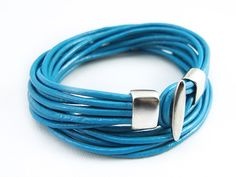 16 Circles Blue Leather Cord Bracelet with Metal Hook. $7.00, via Etsy.