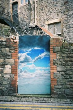 We love the contrast of the beautiful sky set against a brick wall with barbed wire. This is a clever use of background to bring the artwork to life.