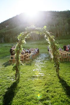 Love the back of this wedding arch as much as the front :) On http://www.StyleMePretty.com/2012/04/12/beaver-creek-wedding-at-beanos-cabin-by-jenna-walker-photographers/ Photography by jennawalkerphotography.com, Floral Design by bellafiori-events.com @bella