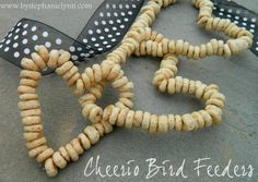 Under The Table and Dreaming: Use Cheerios to Make a Cool Hanging Bird Feeder.  -Wouldn't some of these hung outside like Christmas tree ornaments with some red ribbon just be awesome.