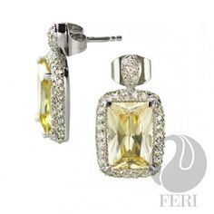 Product #                FSE-6281    Product Category   950 Siledium Silver Collection    - 950 Siledium formulation   - 0.5 micron natural rhodium plating  - Wt. 5.44/gm.  - Size Oct. 12 x 8mm  - Set with AAA white cubic zirconia and a center yellow cubic zirconia  - Dimension: 23mm x 13mm    Invest with confidence in FERI Designer Lines                                                                                           Perches from My Virtual Designer Mall (VDM)…