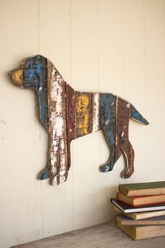 "Made from a variety of reclaimed wood, this friendly wall piece boasts rustic and aged beauty that is sure to charm art and dog lovers alike. 26"" x 18""t"