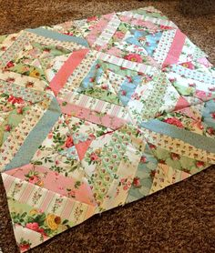 "Summer In The Park quilt pattern, made with Northcott Fabric jelly roll in ""Charlotte""."