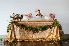 Cake Table by Cakewalk Bake Shop, styled by Bows and Arrows Flowers // photo by Heather Hawkins Photography