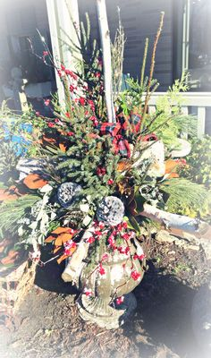 Porch Pot created on site by a Lexington Floral designer~ featuring Birch Poles, All-Weather Berries, Birch Branches, accent Pine Cones, and Magnolia.