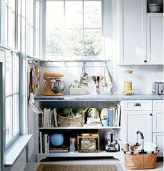 """""""In addition to making a kitchen look older, open shelves can also make a kitchen look bigger.""""  From Cottage Living."""""""