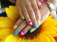 Acrylic nails with bright gelish gel polish polka dots and love hearts Acrylic nails with bright gelish gel polish polka dots and love hearts