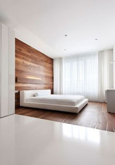 minimal bedroom with wood floor and wall