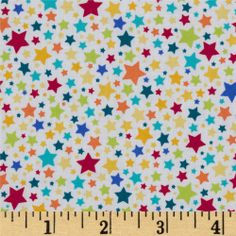 Michael Miller Pierres Famous Traveling Circus Starlettes Multi  Designed for Michael Miller Fabrics, this cotton print features multi-sized stars. Colors include red, orange, lime, aqua, yellow and blue on a white background. Use for quilting and craft projects as well as apparel and home décor accents.
