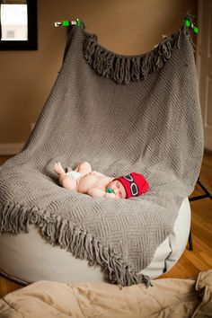 Newborn portrait setup using Posey Pillow, light stands, & blanket as backdrop