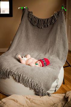 Newborn portrait setup using Posey Pillow, light stands, & blanket as backdrop