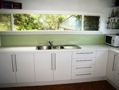 Love the glass splash back. Love that the window is there instead of cupboards, although thinking ours will be taller?