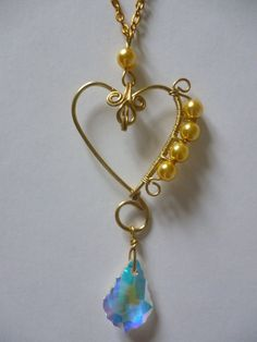 Wired gold heart and crystal pendant by Ilyere