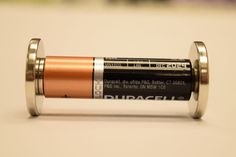 All you need is three magnets, one AA battery, and aluminum foil