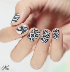 Mix and Match monochrome nail art with a variety of designs (The Mighty Red Baron) seen on PSHIIIT - a lovely design where any one could be used as a standout nail too...x