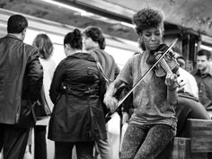 NYC. Violin music on the subway. It's as if the sound colored the b/w image // 500px by Roman K