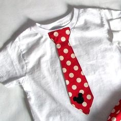 Mickey mouse applique tie... tie hangs free. Listing includes onesie or T-shirt with tie and Mickey applique. via Etsy