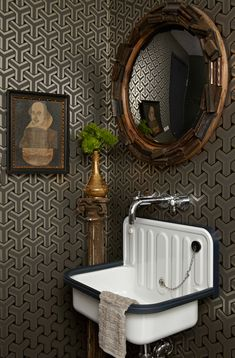 Geometric wallpaper in the powder room adds a sense of depth to the small space. - Traditional Home ®/ Photo: Dominique Vorillon / Design: Tamara Kaye-Honey