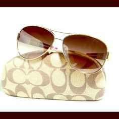 AUTHENTIC COACH NEW aviator sunglasses... Very versatile. Dress it up or down... Fit great and the coach pattern in the arms. They are both the same pair of glasses, just different lighting n camera. Coach Accessories