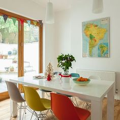 Modern white dining room with multi-coloured chairs   Dining room decorating   Ideal Home   Housetohome.co.uk