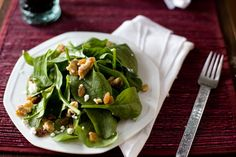 baby spinach  chopped walnuts  crumbled feta  dried fruit like cranberries or raisins