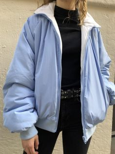 c28811eda Puffy oversized reversible jacket in white and light blue with light blue  trim, and zipper closure pockets for both sides.