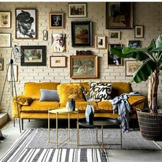 living room | home decor | industrial | modern | gallery wall | yellow sofa | white brick wall | indoor plants