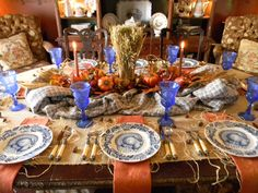 Nancy's Daily Dish: Blue and Orange Thanksgiving Table.    I really love the turkey plates and the color scheme!  The centerpiece is awesome too!