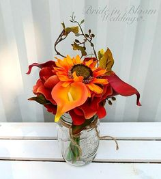 Wedding centrepiece Fall Mason jar flower arrangement