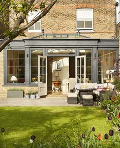 This striking, Westbury Black orangery brings the outside in, making the most of the outdoors when living in city suburbs Orangery Extension Kitchen, Orangerie Extension, Kitchen Orangery, Conservatory Extension, House Extension Design, Glass Extension, House Design, Garden Room Extensions, House Extensions