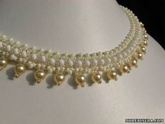 Easy necklace.  Can replace pearls with dangles or crystal.  Could translate but full picture tute.