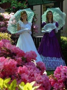 Colorful Azalea Belles guide visitors through the Azalea Trails in colorful Antebellum dresses.