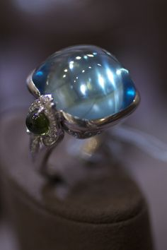 Goshwara topaz and peridot ring with diamonds