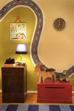 Magnetic Paint + Magnets + Toy Cars = A happy boy.  Use magnetic paint to paint a road on the wall, attach magnets to toy cars, and you have a space-saving toy and cool wall decor.