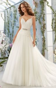 Mori Lee 5411 is a dreamy net ball gown with an emboidered bodice and satin shoulder straps.  The gown includes a removable beaded organza tie sash.